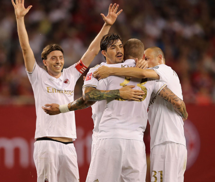 CHICAGO, IL - JULY 27: Andrea Bertollaci (2ndR) of Milan celebrates his goal together with teammates Riccardo Montolivo, Alessio Romagnoli and Luca Antonelli (L-R) during the International Champions Cup between FC Bayern Muenchen and AC Milan of AUDI Summer Tour USA 2016 at Soldier Field on July 27, 2016 in Chicago, Illinois. (Photo by Alexandra Beier/Bongarts/Getty Images)